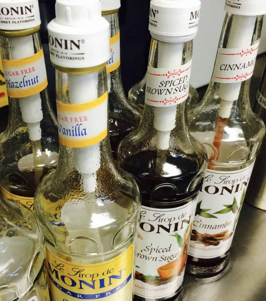 assortment of syrup flavors by monin 904x1024 - What to Expect at Your Event - The Funky Brewster Coffee Catering