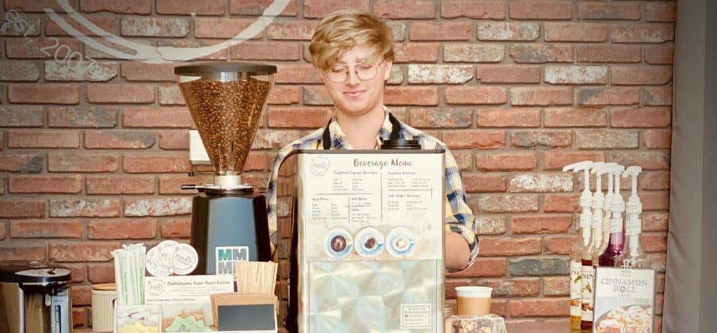 barista at coffee cart zoomed in 1024x476 - Starbucks Catering - The Funky Brewster Coffee Catering